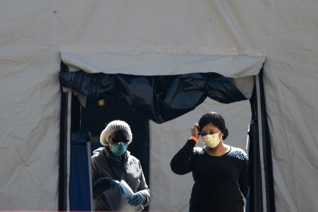 A woman enters a Coronavirus, COVID-19, screening site at FedEx Field, the home of the Washington Redskins, in Landover, Maryland, on Monday. Photo by Kevin Dietsch/UPI