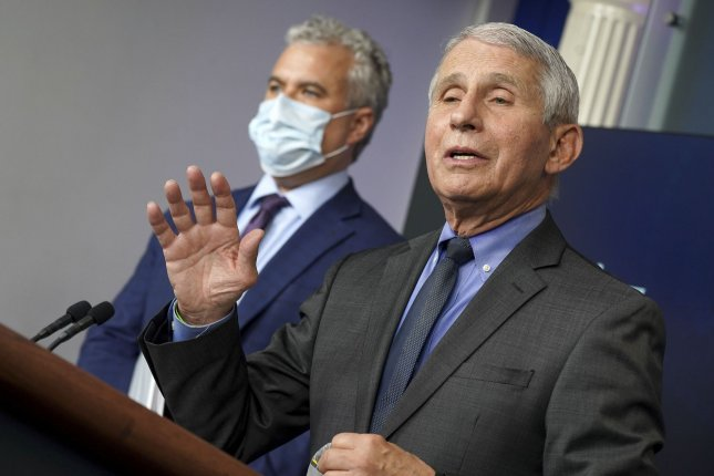 Chief Medical Advisor to the President Dr. Anthony Fauci answers questions as COVID-19 Response Coordinator Jeff Zients listens during a news conference Tuesday. Photo by Leigh Vogel/UPI