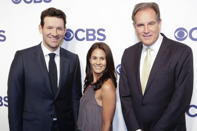 Former NFL quarterback Tony Romo (L), who works as a CBS Sports analyst alongside Tracy Wolfson (C) and Jim Nantz (R), received a sponsor's exemption to play in a Korn Ferry Tour golf event this week in Arlington, Texas. File Photo by John Angelillo/UPI