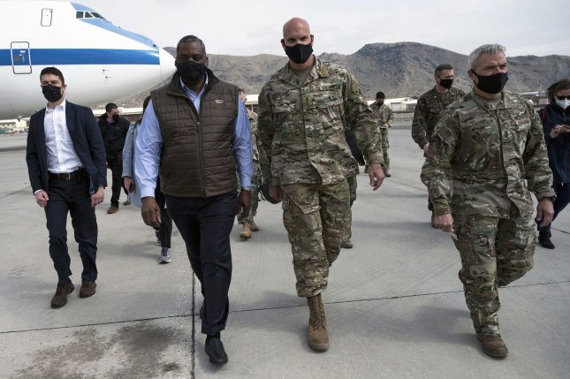 Secretary of Defense Lloyd J. Austin III walks with the commander of Combined Security Transition Command–Afghanistan, Army Lt. Gen. E. John Deedrick Jr., in Kabul in March. Photo by Lisa Ferdinando/DoD