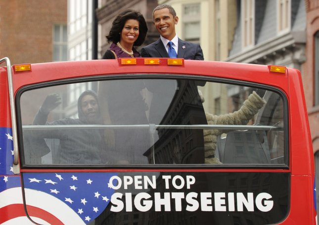 Madame Tussauds wax figures of US President Barack Obama and First Lady Michelle Obama are displayed in a an open top bus as part of a pre-inaugural promotion at the famous wax museum, Washington, DC, January 17, 2013. The Fifth-seventh Presidential Inauguration takes place January 21, 2013. UPI/Mike Theiler
