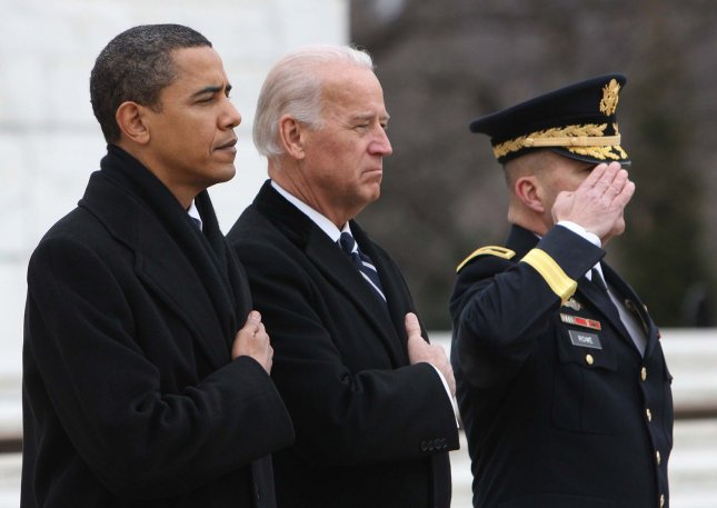 President-elect Barak Obama, Vice President-elect Joe Biden and Maj. Gen. Richard Rowe , Commander Military District of Washington, pay their respects at the Tomb of the Unknown Soldier at Arlington National Cemetery in Arlington, Virginia on January 18, 2009. (UPI Photo/Dennis Brack/Pool)