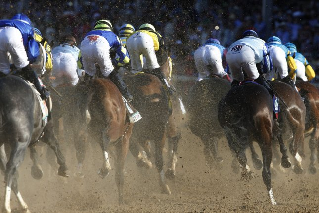 Horses round the first turn in the 141st running of the Kentucky Derby at Churchill Downs on May 2, 2015 in Louisville, Kentucky. Photo by John Sommers /UPI