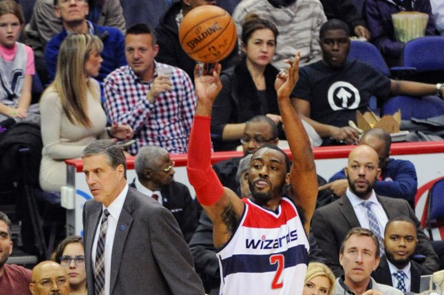 Washington Wizards guard John Wall (2) scores on a jumpshot. File photo by Mark Goldman/UPI