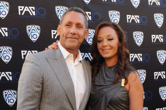 Angelo Pagan (L) and Leah Remini attend FOX Sports/PAC-10 Conference Hollywood premiere night in Los Angeles on July 29, 2010. Remini has joined the Season 2 cast of Kevin Can Wait. File Photo by Jim Ruymen/UPI