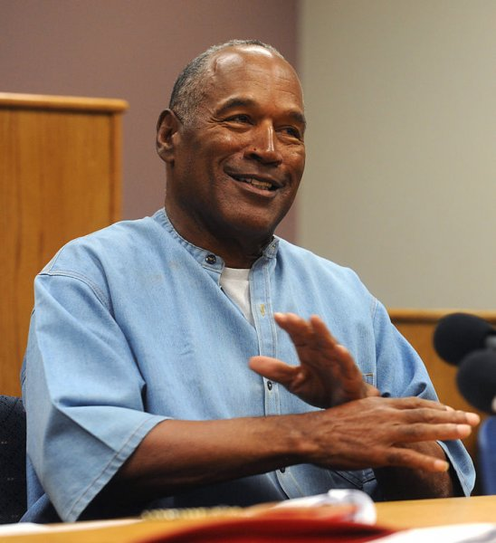 O.J. Simpson reacts after learning he was granted parole at Lovelock Correctional Center in Lovelock, Nevada. Pool photo by Jason Bean/UPI
