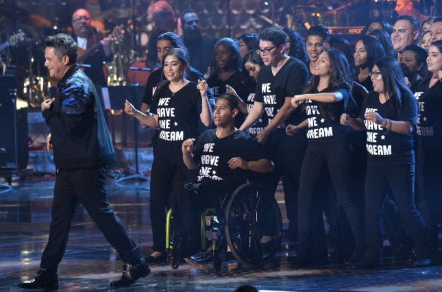 Alejandro Sanz performs onstage during the Latin Grammy Awards with 30 DACA recipients on Thursday. Photo by Jim Ruymen/UPI