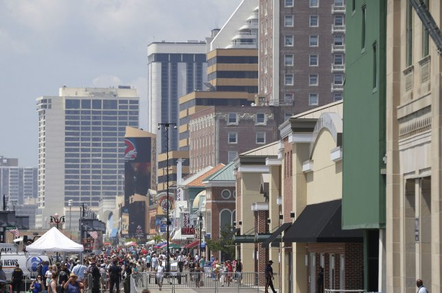 People gather on the boardwalk in Atlantic City, N.J., a popular location for a large conglomerate of hotels. File Photo by John Angelillo/UPI