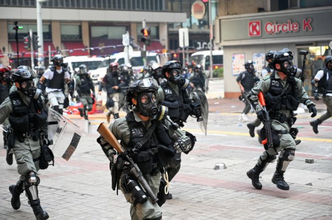 Police charge down the street during clashes with protesters in Hong Kong on Tuesday, Oct. 1, 2019. Photo by Thomas Maresca/UPI