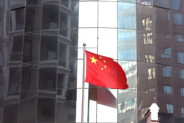 The Chinese national flag flies in Beijing, China, last Wednesday. State media on Tuesday slammed a proposal to sell TikTok to U.S. company Microsoft. Photo by Stephen Shaver/UPI