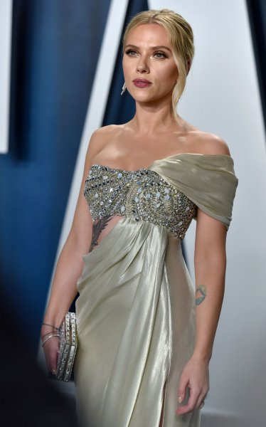 Scarlett Johansson arrives for the Vanity Fair Oscar party at the Wallis Annenberg Center for the Performing Arts in Beverly Hills, Calif., on February 9, 2020. She sued Disney on Thursday for releasing Black Widow on streaming and in theaters on the same day. File Photo by Chris Chew/UPI