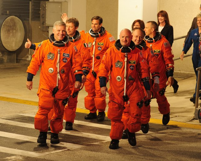 The crew of NASA's space shuttle Endeavour, Greg Johnson, Roberto Vittori, Greg Chamitoff, Commander Mark Kelly, Mike Fincke and Drew Feustel (left to right), depart from their crew quarters to Launch Complex 39A at the Kennedy Space Center on May 16, 2011. Endeavour and her crew are flying on a fourteen day mission, STS 134. This is Endeavour's twenty fifth and final mission, and is set to deliver the Alpha Magnetic Spectrometer and a pallet called the Express Logistics Carrier #3, which will contain spare parts to equip the outpost after the shuttle program ends later this year. UPI/Joe Marino - Bill Cantrell
