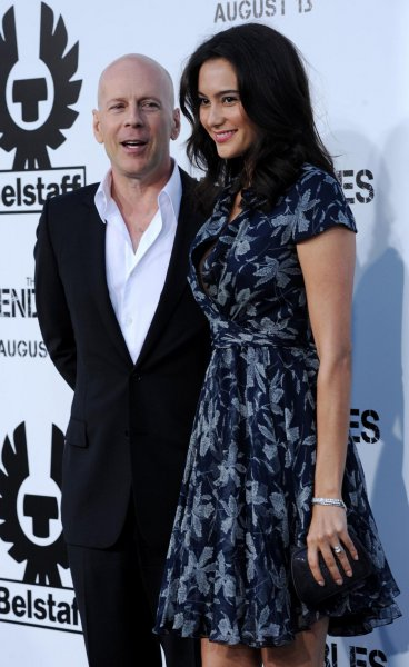 Cast member Bruce Willis attends the premiere of the motion picture thriller The Expendables with his wife Emma Heming (R) at Grauman's Chinese Theatre in the Hollywood section of Los Angeles on August 3, 2010. UPI/Jim Ruymen