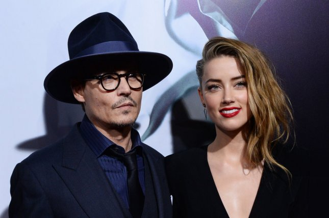Amber Heard (R) and Johnny Depp have reportedly put their wedding plans on hold. UPI/Jim Ruymen