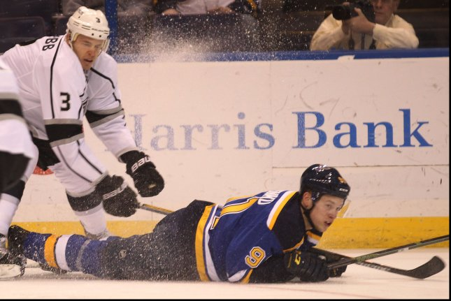 St. Louis Blues' Vladimir Tarasenko of Russia is leveled by Los Angeles Kings' Brayden McNabb in the first period at the Scottrade Center in St. Louis on February 18, 2016. Photo by Bill Greenblatt/UPI