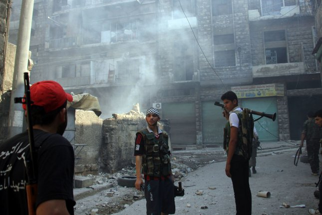 Syrian rebel fighters survey the situation in Aleppo, Syria, September 12, 2012. File photo UPI/Ahmad Deeb
