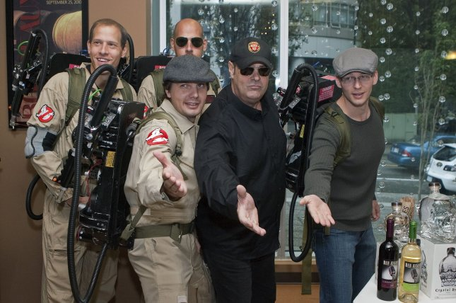 Dan Aykroyd (in black) poses with fans dressed as Ghostbusters at the new BC Liquor Signature Store on Bute Street during a public bottle signing promoting his Patron Tequila on September 23, 2010. Aykroyd has praised the upcoming Ghostbusters revival on Facebook starring Kristen Wiig, Melissa McCarthy, Leslie Jones and Kate McKinnon. File Photo by Heinz Ruckemann/UPI