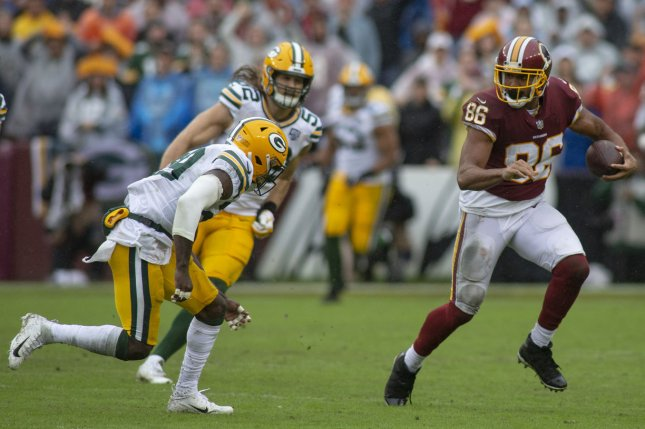4a6757fb8 Washington Redskins tight end Jordan Reed (86) runs with the football while  two Green Bay Packers defenders look to tackle him on September 23 s at  FedEx ...
