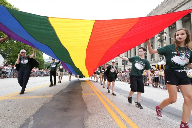 Marchers carry the LGBT pride flag during the St. Louis PrideFest Parade in Missouri, a state that received the lowest ranking of High Priority to Achieve Basic Equality in the annual State Equality Index ratings. Photo by Bill Greenblatt/UPI