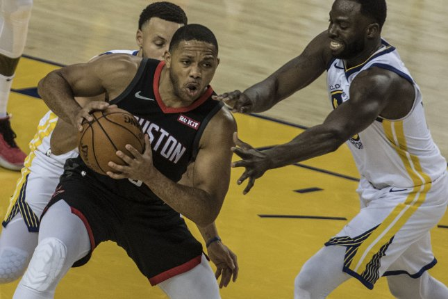 Houston Rockets guard Eric Gordon (L) will earn about $90 million over the next five seasons. File Photo by Terry Schmitt/UPI