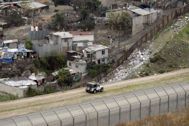 A United States Border Patrol vehicle cruises between the primary and secondary fence line on the Tijuana, Mexico border in San Diego, December 20, 2007. The area has been the site of alleged increased violence against the Border Patrol. The Border Patrol says its agents were attacked nearly 1,000 times during a one-year period along the Mexican border, typically by assailants hurling rocks, bottles and bricks. Now the agency is responding with tear gas and powerful pepper-spray weapons firing into Mexico. (UPI Photo/Earl Cryer)