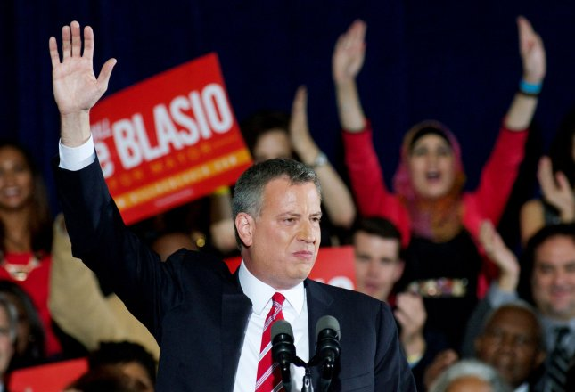 Democratic candidate Bill de Blasio waves to supporters after winning the mayoral election at the Park Slope Armory campaign headquarters on November 5, 2013, in New York. De Blasio ran against Republican Joseph Lhota and becomes the first new mayor in twelve years, replacing Michael Bloomberg. UPI/Monika Graff