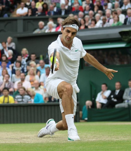 Roger Federer, shown at the 2012 Wimbledon Championships, picked up a straight-set win Thursday in second-round play of the Australian Open. UPI/Hugo Philpott