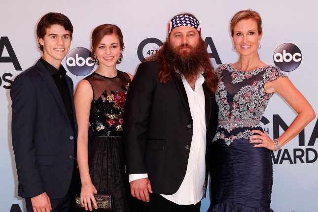 Members of the reality television show Duck Dynasty, including Willie Robertson (2nd-R) and his wife Korie (R) and their children John Luke and Sadie, arrive on the red carpet at the 47th Annual Country Music Awards at the Bridgestone Arena in Nashville, November 6, 2013. UPI/Terry Wyatt