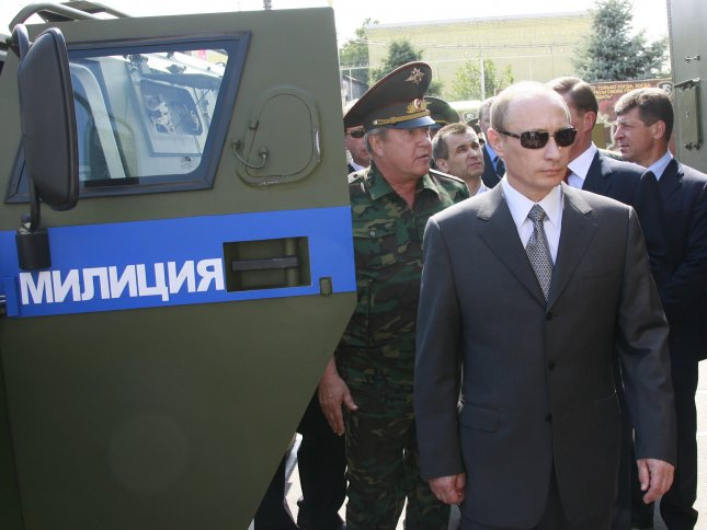 Russian President Vladimir Putin walks past armored police car as he visits the Command and Control Center of the North Caucasus Interior Ministry Troops District in Rostov-on-Don on June 29, 2007. (UPI Photo/Anatoli Zhdanov)