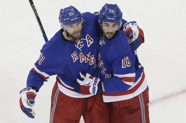 New York Rangers' Rick Nash celebrates with Derick Brassard after scoring a goal in the 2nd period against the Edmonton Oilers at Madison Square Garden in New York City on December 15, 2015. Photo by John Angelillo/UPI