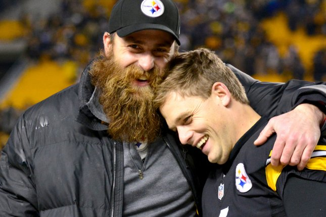 Pittsburgh Steelers kicker Shaun Suisham (6) celebrates the 27-17 win over the Cincinnati Bengals with Pittsburgh Steelers defensive end Brett Keisel (99) at Heinz Field in Pittsburgh on December 28, 2014. UPI/Archie Carpenter
