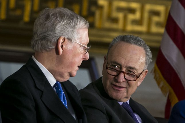 Senate Majority Leader Mitch McConnell, a Republican from Kentucky, and Senate Minority Leader Chuck Schumer, a Democrat from New York, appear during a ceremony for former Senator Bob Dole, on January 17. McConnell promised Democrats a debate and a vote on Dreamers. Photo by Al Drago/UPI