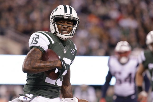 Former New York Jets wide receiver Brandon Marshall (15) carries the  football in the first half against the New England Patriots in Week 12 of  the NFL ... 4fea8d3c5