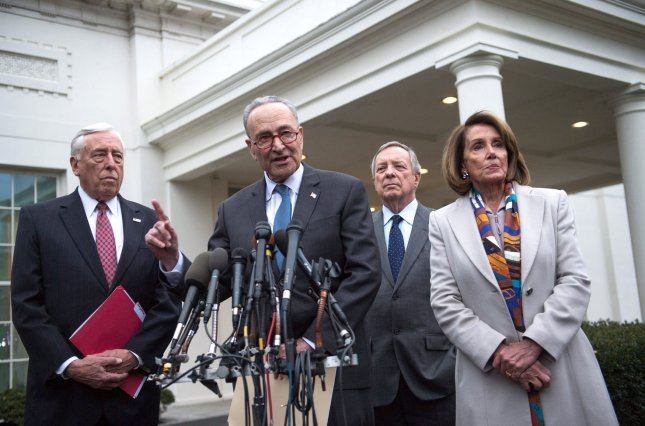 Senate Democratic leader Charles Schumer, joined by incoming Speaker of the House Nancy Pelosi, incoming House Democratic Leader Steny Hoyer, and assistant Senate Democratic leader Richard Durbin, speaks to the media following a meeting between President Donald Trump and congressional leadership to talk about border security Wednesday. Photo by Kevin Dietsch/UPI
