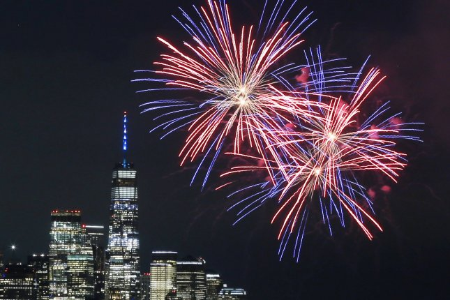 Fireworks for the annual Macy's Fourth of July fireworks show light up the sky on the Hudson River near One World Trade Center and the Manhattan skyline on Tuesday. Photo by John Angelillo/UPI