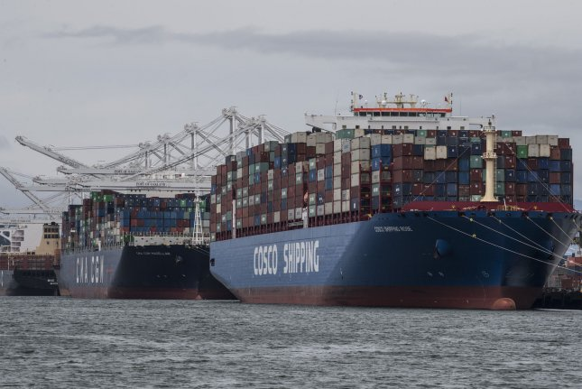 Containers are off-loaded from cargo ships at the Port of Oakland in Oakland, Calif. Thursday's report said maritime trade should rebound next year, if the global economy recovers from the impact of COVID-19. File Photo by Terry Schmitt/UPI