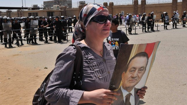 A supporter of deposed president Hosni Mubarak holds a poster as she reacts after a court sentenced Mubarak to life in prison, outside the police academy where the court is located at in Cairo June 2, 2012. UPI/Ahmed Jomaa