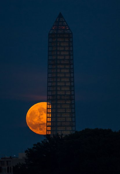 A supermoon rises behind the Washington Monument, June 23, 2013, in Washington. Saturday night, a supermoon will be visible in areas around the world as the moon gets as near to the Earth as it ever gets. Photo by Bill Ingalls/UPI/NASA