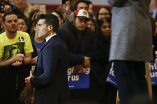 A U.S. Secret Service agent monitors the crowd while Democratic presidential candidate Hillary Clinton speaks to supporters at a 'Get Out the Vote' event at the Chicago Journeyman Plumber's Hall in Chicago on March 14, 2016. Monday, the agency said no firearms will be allowed at the Republican National Convention in Cleveland this summer, no matter how many advoctes sign a petition demanding otherwise. Photo by Kamil Krzaczynski/UPI
