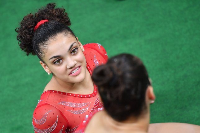 U S Womens Gymnastics Member Laurie Hernandez Talks To Teammate Aly Raisman At The Olympic Park During A Team Practice Session For The Olympics In Rio De