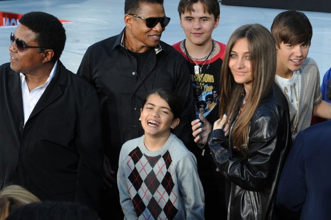 Paris Jackson (second from right) at late dad Michael Jackson's TCL Chinese Theater hand and footprint ceremony on January 26, 2012. File Photo by Jim Ruymen/UPI