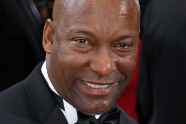 John Singleton arrives on the red carpet at the 82nd Academy Awards in Hollywood on March 7, 2010. Singleton executive produced L.A. Burning: The Riots 25 Years Later, a documentary to debut on A&E next month. File Photo by David Silpa/UPI