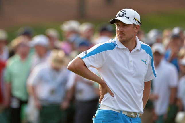Jonas Blixt waits on the 18th green during the final round of the 2014 Masters Tournament. File photo by Kevin Dietsch/UPI
