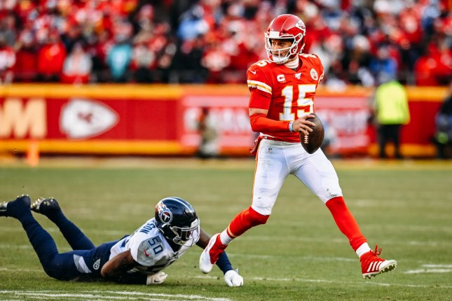 Kansas City Chiefs quarterback Patrick Mahomes (15) rolls out of the pocket on his way to a 27-yard touchdown run against the Tennessee Titans during the second quarter of the AFC Championship Game on Sunday at Arrowhead Stadium in Kansas City. Photo by Jason Hanna/UPI