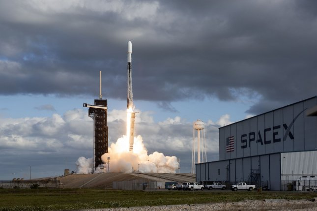 A SpaceX Falcon 9 rocket launches a classified payload for the National Reconnaissance Office from Complex 39 at the Kennedy Space Center, Fla., on Saturday. Photo by Joe Marino/UPI