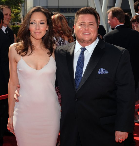 Chaz Bono (R) and his longtime girlfriend Jenniger Elia arrive for the Primetime Creative Arts Emmy Awards at the Nokia Theatre in Los Angeles. File photo. UPI/Jim Ruymen