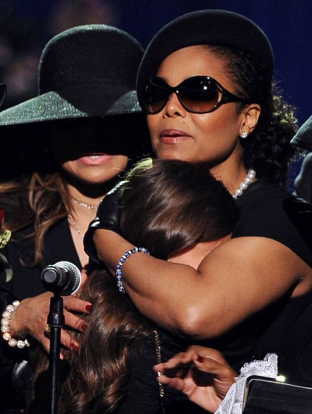 Janet Jackson comforts Paris Jackson during the Jackson public memorial service held at Staples Center in Los Angeles on July 7, 2009. The King of Pop died in Los Angeles on June 25 at age 50. (UPI Photo Photo/Gabriel Bouys/Pool)