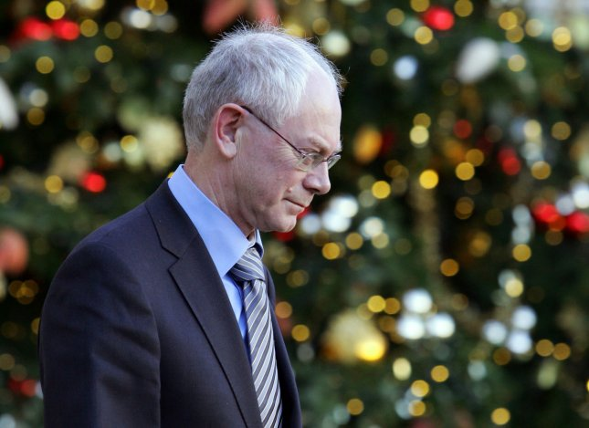 EU Council President Herman Van Rompuy walks past a Christmas tree as he leaves the Elysee Palace, in Paris, December 04, 2008, after meeting with French President Nicolas Sarkozy. UPI/Eco Clement