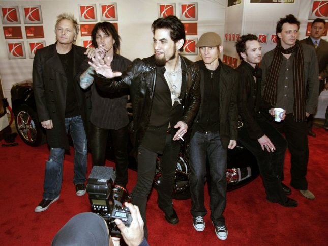 Musician Dave Navarro (center) and the rest of the band Camp Freddy get comfortable on a new 2007 Saturn Sky Red Line at a special event to introduce three new Saturn vehicles -- the Sky Red Line performance roadster, the Outlook crossover vehicle and the Aura midsize sedan -- at the Hard Rock Cafe in Times Square prior to the start of the New York Auto Show Tuesday, April 11, 2006 in New York. (UPI Photo/Emile Wamsteker/GM)