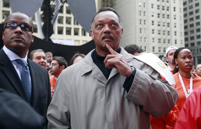 The Rev. Jesse Jackson watches as Chicago was eliminated in the first round of voting by the International Olympic Committee in their bid to host the 2016 Olympics Summer Games at a rally in Daley Plaza in Chicago on October 2, 2009. Chicago and Tokyo were voted out this morning leaving Rio de Janeiro and Madrid as finalists in the bidding process. UPI /Mark Cowan